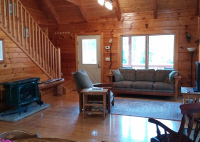 falling water farm vacation rental great room with fireplace, flat screen TV, couch, recliner