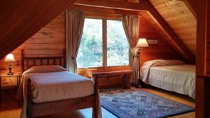 falling water farm vacation rental loft with queen size bed, two twin beds, and full bathroom